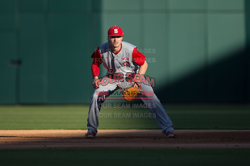 North Carolina State Wolfpack first baseman Preston Palmeiro (12) on defense against the Charlotte 49ers at BB&T Ballpark on March 31, 2015 in Charlotte, North Carolina.  The Wolfpack defeated the 49ers 10-6.  (Brian Westerholt/Four Seam Images)