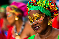 An Afro-Colombian dancer of the Yescagrande neighborhood takes part in the San Pacho festival in Quibdó, Colombia, 1 October 2019. Every year at the turn of September and October, the capital of the Pacific region of Chocó holds the celebrations in honor of Saint Francis of Assisi (locally named as San Pacho), recognized as Intangible Cultural Heritage by UNESCO. Each day carnival groups, wearing bright colorful costumes and representing each neighborhood, dance throughout the city, supported by brass bands playing live music. The festival culminates in a traditional boat ride on the Atrato River, followed by massive religious processions, which accent the pillars of Afro-Colombian's identity – the Catholic devotion grown from African roots.