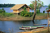 Amazon, Brazil. House built on stilts on the banks of the Rio Negro to accomodate annual rise and fall in river level.