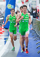 28 APR 2012 - LES SABLES D'OLONNE, FRA - Jonathan Brownlee (E.C.Sartrouville Triathlon) (right) leads team mates Fernando Alarza  (left) and David MacNamee (centre) as they start the second lap of the run leg of the prologue round of the French Grand Prix Series triathlon in Les Sables d'Olonne, France (PHOTO (C) 2012 NIGEL FARROW)