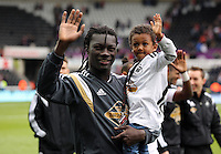 SWANSEA, WALES - MAY 17: Bafetimbi Gomis of Swansea with one of his children after the Premier League match between Swansea City and Manchester City at The Liberty Stadium on May 17, 2015 in Swansea, Wales. (photo by Athena Pictures/Getty Images)
