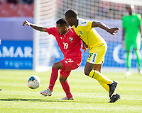 CLEVELAND, OH - JUNE 22: Alberto Quintero #19 is challenged by Jordan Dover #5 during a game between Panama and Guyana at FirstEnergy Stadium on June 22, 2019 in Cleveland, Ohio.