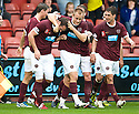 HEARTS' ANDY WEBSTER IS CONGRATULATED AFTER HE SCORES HEARTS' FIRST