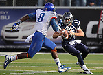 Nevada quarterback Cody Fajardo gets pressured by Boise State's Demarcus Lawrence in the second half of an NCAA college football game on Saturday, Dec. 1, 2012, in Reno, Nev. Boise State won 27-21. (AP Photo/Cathleen Allison)
