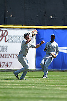 Mobile BayBears outfielder David Peralta (28) catches a fly ball as Justin Greene (2) backs up the play during a game against the Huntsville Stars on April 23, 2014 at Joe Davis Stadium in Huntsville, Tennessee.  Huntsville defeated Mobile 4-1.  (Mike Janes/Four Seam Images)
