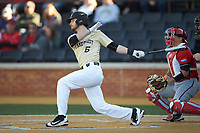 Jake Mueller (6) of the Wake Forest Demon Deacons follows through on his swing against the Gardner-Webb Runnin' Bulldogs at David F. Couch Ballpark on February 18, 2018 in  Winston-Salem, North Carolina. The Demon Deacons defeated the Runnin' Bulldogs 8-4 in game one of a double-header.  (Brian Westerholt/Four Seam Images)