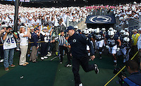 State College, PA - 10/12/2013:  Head coach Bill O'Brien leads his team onto the field before the game.  Penn State defeated Michigan by a score of 43-40 in four overtimes on Saturday, October 12, 2013, at Beaver Stadium.<br /> <br /> Photos by Joe Rokita / JoeRokita.com