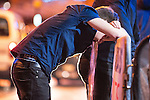 © Joel Goodman - 07973 332324 . 01/01/2016 . Manchester , UK . A man vomits copiously . Revellers in Manchester on a New Year night out at the clubs around the city centre's Printworks venue . Photo credit : Joel Goodman