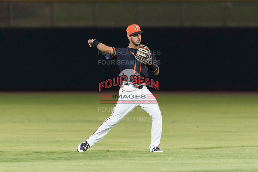 AZL Giants Black shortstop Enoc Watts (83) throws to second base during an Arizona League game against the AZL Rangers at Scottsdale Stadium on August 4, 2018 in Scottsdale, Arizona. The AZL Giants Black defeated the AZL Rangers by a score of 6-3 in the second game of a doubleheader. (Zachary Lucy/Four Seam Images)