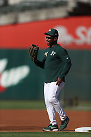 OAKLAND, CA - SEPTEMBER 4:  Coach Rickey Henderson #24 of the Oakland Athletics works out at first base during batting practice before the game against the Los Angeles Angels at the Oakland Coliseum on Wednesday, September 4, 2019 in Oakland, California. (Photo by Brad Mangin)