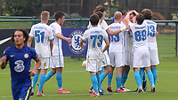 Zenit St Petersburg players congratulate Evgeny Kim after scoring their opening goal during Chelsea Under-19 vs FC Zenit Under-19, UEFA Youth League Football at Cobham Training Ground on 14th September 2021