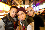 B-Boys Taisuke, Ronnie and Lilou pose in Hong Kong's Causeway Bay district.