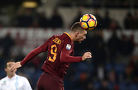 Calcio, Serie A: Roma vs ChievoVerona. Roma, stadio Olimpico, 22 settembre 2016.<br /> Roma's Edin Dzeko heads the ball during the Italian Serie A football match between Roma and Chievo Verona, at Rome's Olympic stadium, 22 December 2016.<br /> UPDATE IMAGES PRESS/Isabella Bonotto