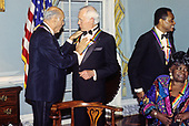 """The recipients of the 16th Annual Kennedy Center Honors share an informal moment as they pose for a group photo following a dinner at the United States Department of State in Washington, D.C. on Saturday, December 4, 1993.  From left to right: conductor Georg Solti, former """"Tonight Show"""" host Johnny Carson, Arthur Mitchell, founder of the Dance Theatre of Harlem and gospel singer Marion Williams.  The 1993 honorees are: Johnny Carson, Arthur Mitchell, Georg Solti Stephen Sondheim and Marion Williams.<br /> Credit: Greg E. Mathieson / Pool via CNP"""