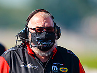 Aug 8, 2020; Clermont, Indiana, USA; Crew member for NHRA funny car driver Tommy Johnson Jr (not pictured) wears a face mask covering during qualifying for the Indy Nationals at Lucas Oil Raceway. Mandatory Credit: Mark J. Rebilas-USA TODAY Sports
