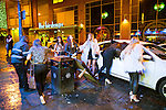 """© Joel Goodman - 07973 332324 . 17/12/2016 . Manchester , UK . Women flag a cab on Withy Grove . Revellers out in Manchester City Centre overnight during """" Mad Friday """" , named for being one of the busiest nights of the year for the emergency services in the UK . Photo credit : Joel Goodman"""