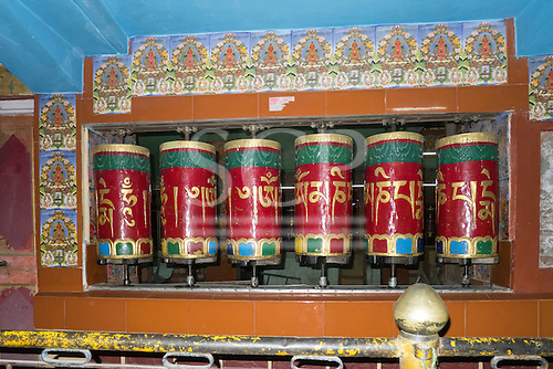 Himachal Pradesh, India. Buddhist prayer wheels in a small shrine on the road from Dharamsala to Shimla.
