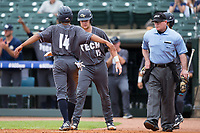 Austin Wilhite (14) of the Georgia Tech Yellow Jackets is greeted by teammate Kyle McCann (15) after scoring a run against the Miami Hurricanes during Game One of the 2017 ACC Baseball Championship at Louisville Slugger Field on May 23, 2017 in Louisville, Kentucky.  The Hurricanes walked-off the Yellow Jackets 6-5 in 13 innings. (Brian Westerholt/Four Seam Images)