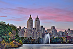 View of the El Dorado and other buildings on the west side of Central Park, seen across the Jacqueline Kennedy Onassis Reservoir at sunset