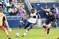 KANSAS CITY, KS - MAY 16: Cristian Dajome #11 Vancouver Whitecaps shoots on goal during a game between Vancouver Whitecaps and Sporting Kansas City at Children's Mercy Park on May 16, 2021 in Kansas City, Kansas.