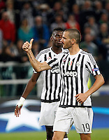 Calcio, Champions League: Gruppo D - Juventus vs Siviglia. Torino, Juventus Stadium, 30 settembre 2015. <br /> Juventus' Leonardo Bonucci, right, gestures past teammate Paul Pogba during the Group D Champions League football match between Juventus and Sevilla at Turin's Juventus Stadium, 30 September 2015. <br /> UPDATE IMAGES PRESS/Isabella Bonotto