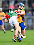 Tadgh Shanahan of Clooney-Quin in action against Brian Corry of  Sixmilebridge during their senior county final replay at Cusack park. Photograph by John Kelly.