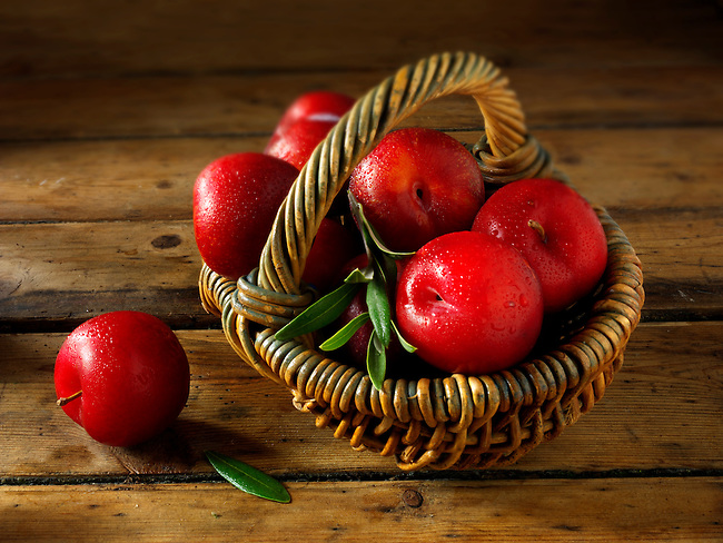Fresh whole red plums