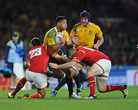 Israel Folau of Australia is tackled by James Hook and Ken Owens of Wales during Match 35 of the Rugby World Cup 2015 between Australia and Wales - 10/10/2015 - Twickenham Stadium, London<br /> Mandatory Credit: Rob Munro/Stewart Communications