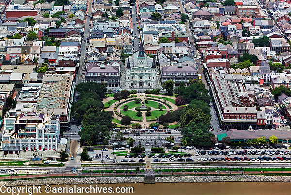 aerial photograph of the French Quarter including Washington Artillery Park, Jackson Square, St. Louis Cathedral, New Orleans, Louisiana, Mississippi River in the foreground