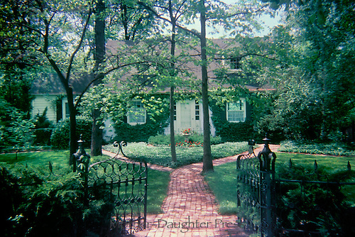 Gate to yard with brick walkway