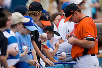 Zach Booker #49 of the Norfolk Tides signs autographs prior to the game at Harbor Park June 7, 2009 in Norfolk, Virginia. (Photo by Brian Westerholt / Four Seam Images)