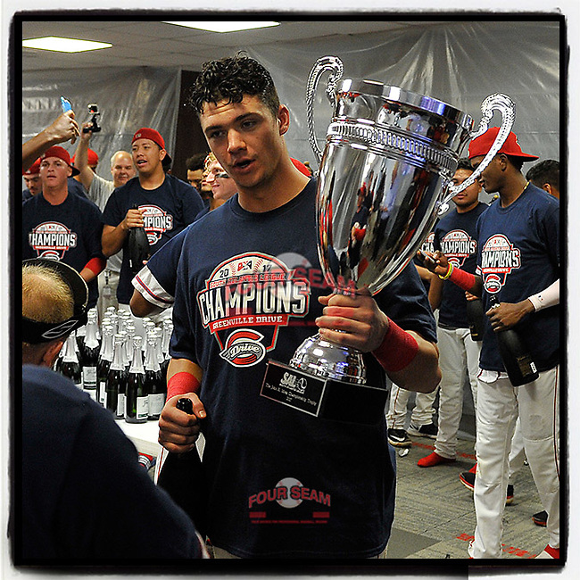 Third baseman Bobby Dalbec (23) holds the trophy in the clubhouse as the team celebrates its 2017 South Atlantic League Championship following an 8-3 win over the Kannapolis Intimidators in Game 4 of the Championship Series on Friday, September 15, 2017, at Fluor Field at the West End in Greenville, South Carolina. It was Greenville's first SAL Championship. Greenville won the series 3-1. (Tom Priddy/Four Seam Images)
