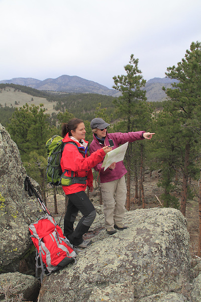 Women navigating with map and compass, Front Range, Colorado.