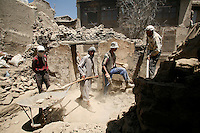 Men clearing rubble around historic building. Turquoise Mountain Foundation is working to preserve Afghanistan's traditional crafts and historical buildings. In Kabul, work has started in the historic Murad Khane part of Kabul, and is largely completed in the royal Kart-e-Parwan fort.
