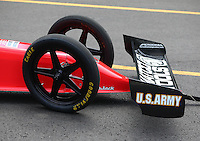 Aug. 2, 2014; Kent, WA, USA; Detailed view of the front wing and front wheels on the NHRA top fuel dragster of driver Antron Brown during qualifying for the Northwest Nationals at Pacific Raceways. Mandatory Credit: Mark J. Rebilas-