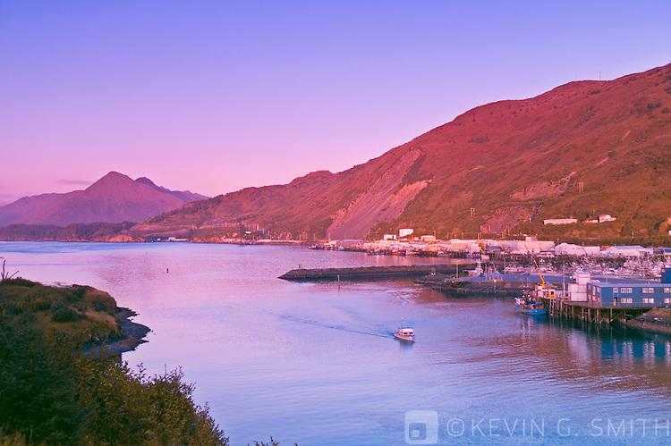 St. Paul Harbour at sunrise as seen accross Chiniak Bay from Near Island, fall, Kodiak Alaska, USA.