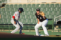 Corey Zangari (14) of the Kannapolis Intimidators waits for a pick-off throw as Luis Alejandro Basabe (5) of the Greenville Drive heads back towards first base at Intimidators Stadium on June 7, 2016 in Kannapolis, North Carolina.  The Drive defeated the Intimidators 5-2 in game two of a double header.  (Brian Westerholt/Four Seam Images)