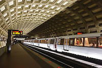 A subway train ready to depart DC Metro Gallery Place - Chinatown station