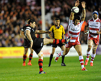 Phil Burleigh of Edinburgh Rugby sends up a kick as James Hook of Gloucester Rugby attempts to block