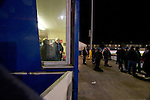 Cammell Laird 1 Witton Albion 2, 12/12/2008. Kirklands, Unibond League premier division. Directors of Cammell Laird FC in the committee room watching the players warming up before their Unibond League premier division at Kirklands, Birkenhead against Witton Albion. The visitors won by 2 goals to 1 on front of a crowd of just 136. Formed in 1907, Lairds joined the English pyramid in 2004 and gained three promotions in five years, but financial problems forced the club to revert to amateur status in December 2008. Photo by Colin McPherson
