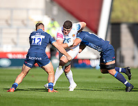 3rd October 2021; AJ Bell stadium, Eccles, Greater Manchester, England: Gallagher Premiership Rugby, Sale v Exeter ;  Dave Ewers of Exeter Chiefs is tackled by  Jono Ross (C) and  Sam Hill of Sale Sharks