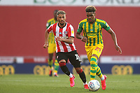 Grady Diangana of West Brom, on loan from West Ham, in possession as Brentford's Said Benrahma looks on during Brentford vs West Bromwich Albion, Sky Bet EFL Championship Football at Griffin Park on 26th June 2020