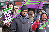 Striking Camden civil enforcement officers (traffic wardens) employed by private contractor NSL march through Camden Town to demand fair pay (£11.15 an hour) during five days of industrial action..