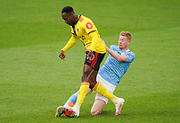 Danny Welbeck of Watford and Kevin De Bruyne of Man City during the Premier League match between Watford and Manchester City at Vicarage Road, Watford, England on 21 July 2020. Football Stadiums around remain empty due to the Covid-19 Pandemic as Government social distancing laws prohibit supporters inside venues resulting in all fixtures being played behind closed doors until further notice.<br /> Photo by Andy Rowland.