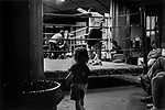 A little girl in front of the ring during an Amateur fight at Gleason's Gym in Brooklyn, New York.<br />Photograph by Thierry Gourjon-Bieltvedt. 1995-2005
