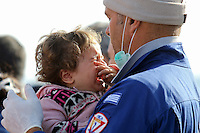 Pictured: A young girl is crying as she is helped to safety by a member of the emergency services Thursday 27 November 2014<br />
