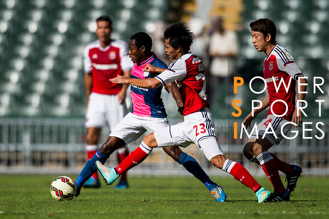 Christian Kwesi Annan of Kitchee (L) being followed by Runqiu Che of SCAA (R) during the HKFA Premier League between South China Athletic Association vs Kitchee at the Hong Kong Stadium on 23 November 2014 in Hong Kong, China. Photo by Aitor Alcalde / Power Sport Images