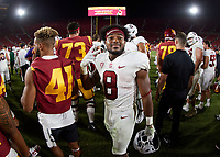 LOS ANGELES, CA - SEPTEMBER 11: Nathaniel Peat #8 of the Stanford Cardinal reacts to the win after a game between University of Southern California and Stanford Football at Los Angeles Memorial Coliseum on September 11, 2021 in Los Angeles, California.