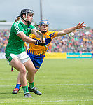 Darragh O Donovan of Limerick in action against Podge Collins of Clare during their Munster championship game in Ennis. Photograph by John Kelly.