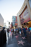 Tourists and costumed characters in front of the Dolby Theatre (formerly Kodak Theatre) at Hollywood & Highland Center in Hollywood, Los Angeles, CA